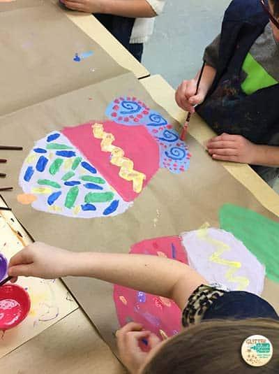 2nd grade students painting wayne thiebaud cupcakes