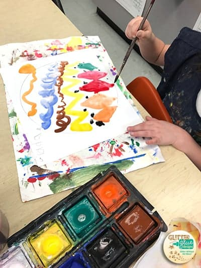 Student tempera painting his dot for International Dot Day