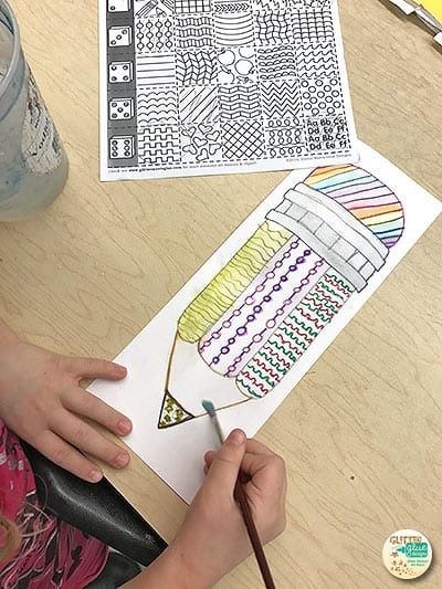 4th grade student designing a pencil art lesson