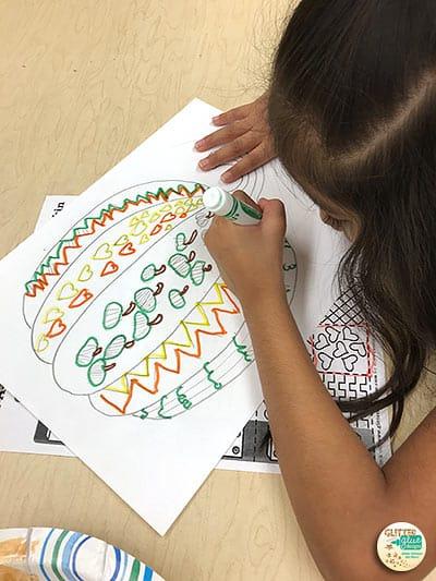 first grade student drawing a pumpkin