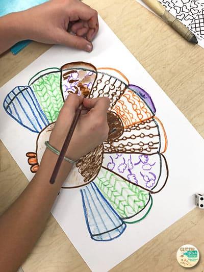 4th grade kid painting their thanksgiving turkey craft
