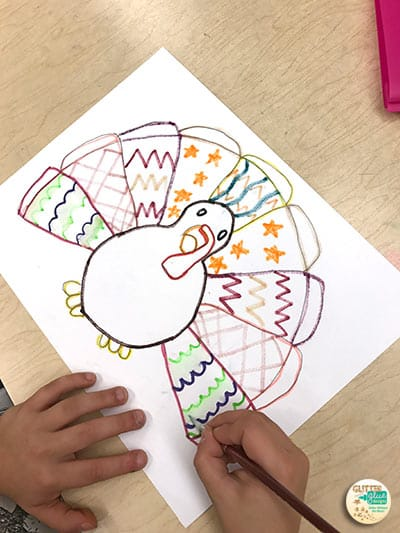 fourth grader painting her artwork