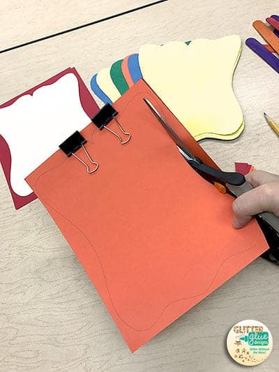 Use binder clips to hold paper together when cutting.