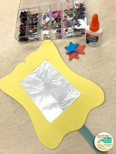 Gather art materials to decorate your hand mirror.