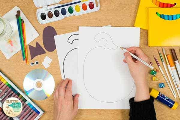 Trace the pumpkin onto heavy white sulphate drawing paper.