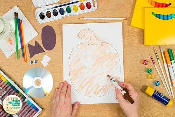 Paint the pumpkin with markers.