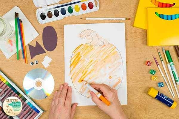 Add color to the pumpkin art project.