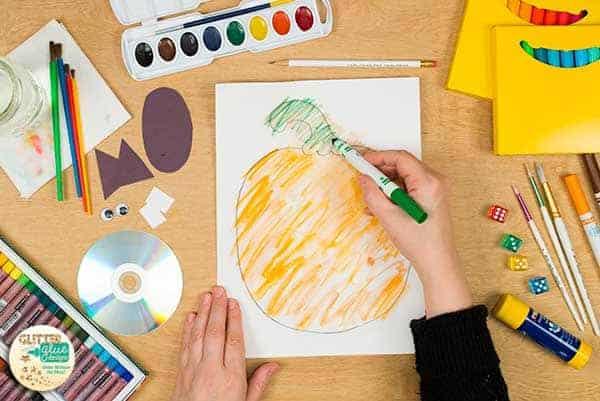 Add green marker to the pumpkin stem.