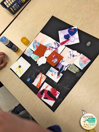 Kindergartener using painted paper and foam shapes for a collage.