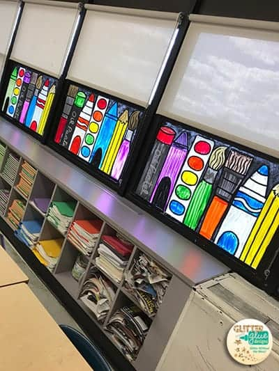 Art room window painting of a rainbow school supplies