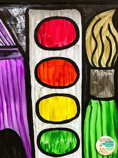 Window painting of a crayon, paintbrush, and paint palette