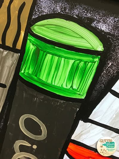 Close up of a green oil pastel window painting