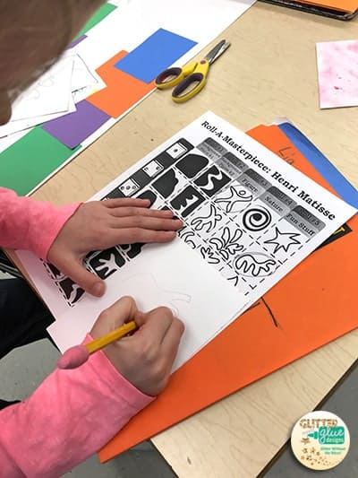 Student drawing Henri Matisse shapes from roll-a-dice game.