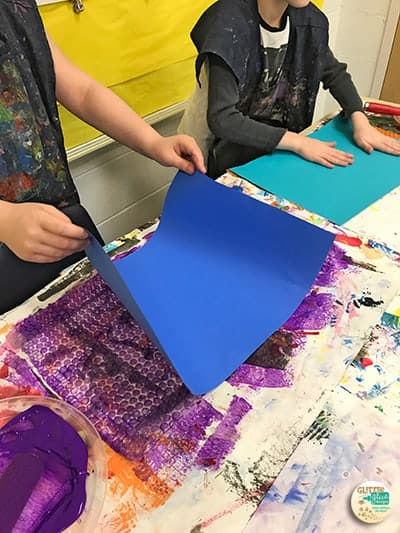 students printing their benday dot backgrounds with bubblewrap and tempera paint