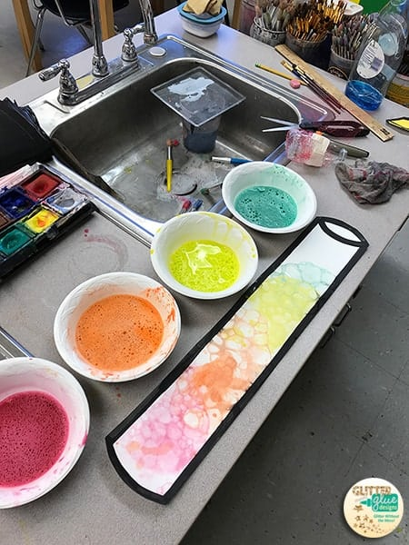 Mixing tempera paint, water, and liquid soap for bubble painting