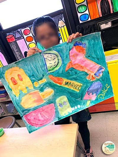 5th grade student showing her pop art painting