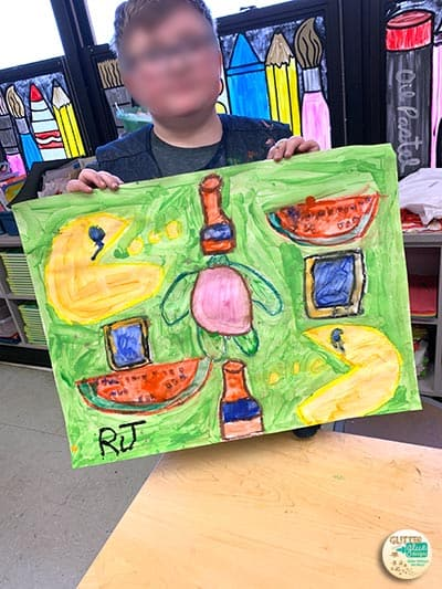 5th grade boy showing his katherine bernhardt painting