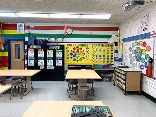 my elementary art room featuring a rainbow mural