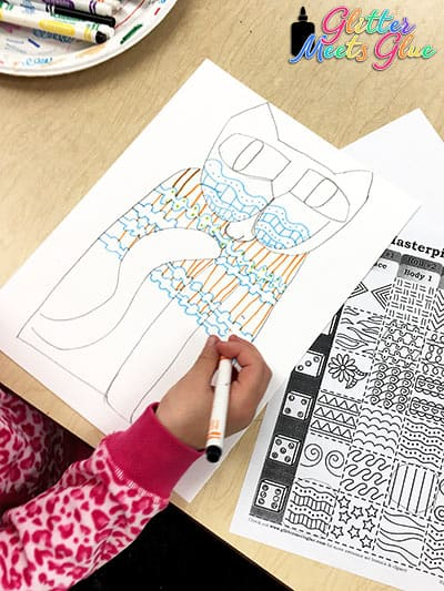 2nd grade student drawing patterns on cat