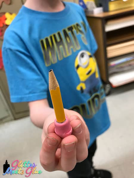 kid holding a pencil stub